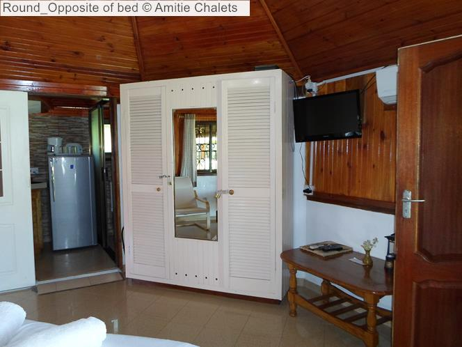 Round Opposite of bed Amitie Chalets