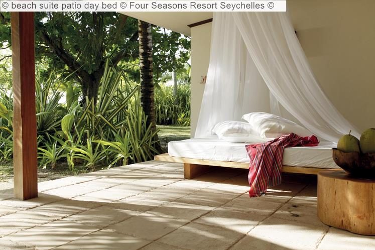 beach suite patio day bed Four Seasons Resort Seychelles
