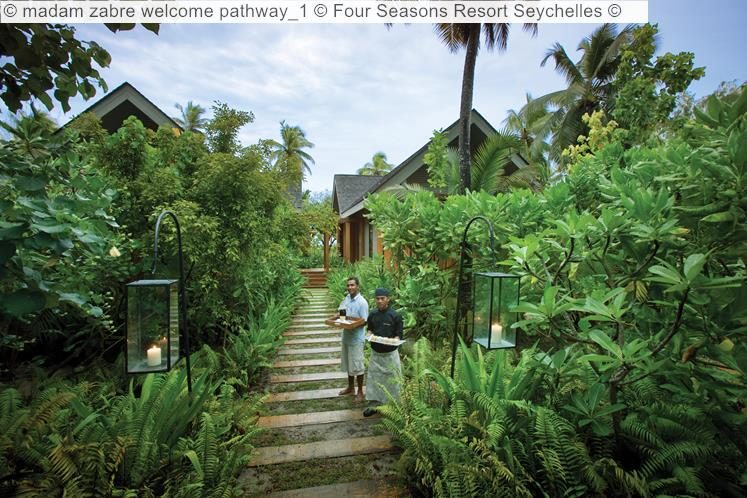 madam zabre welcome pathway Four Seasons Resort Seychelles