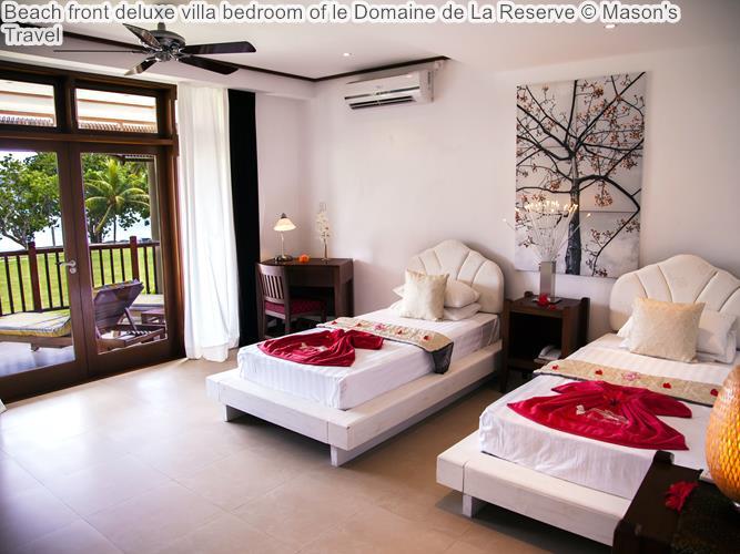 Beach front deluxe villa bedroom of le Domaine de La Reserve
