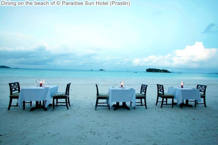 Dining on the beach of Paradise Sun Hotel Praslin