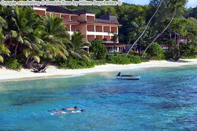 Couple snorkeling DoubleTree by Hilton Seychelles